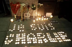 """The words """"I am Charlie"""" are spelled out with candles at a gathering in solidarity with those killed in an attack at the Paris offices of the weekly newspaper Charlie Hebdo on Wednesday, Jan. 7, 2015,  outside the French Consulate in San Francisco. (AP Photo/Marcio Jose Sanchez)"""