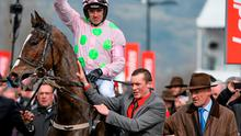 Jockey Ruby Walsh is led into the winner's enclosure, with trainer Willie Mullins, after victory in the JLT Novices Chase on Vautour. Cheltenham Racing Festival 2015, Prestbury Park, Cheltenham, England. Picture credit: Ramsey Cardy / SPORTSFILE