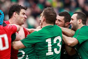 Mike Phillips (left) becomes involved with Rob Kearney at the Aviva Stadium.