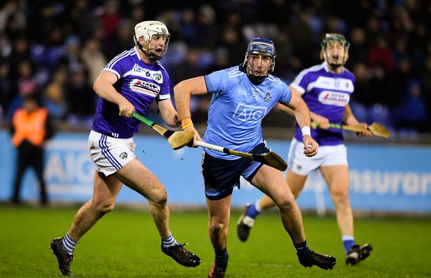 John Hetherton of Dublin in action against Ryan Mulllaney of Laois during the Walsh Cup clash at Parnell Park in Dublin. Photo: Matt Browne/Sportsfile