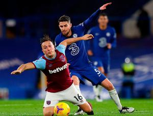 West Ham United's Mark Noble and Chelsea's Jorginho battle for the ball. Photo: PA