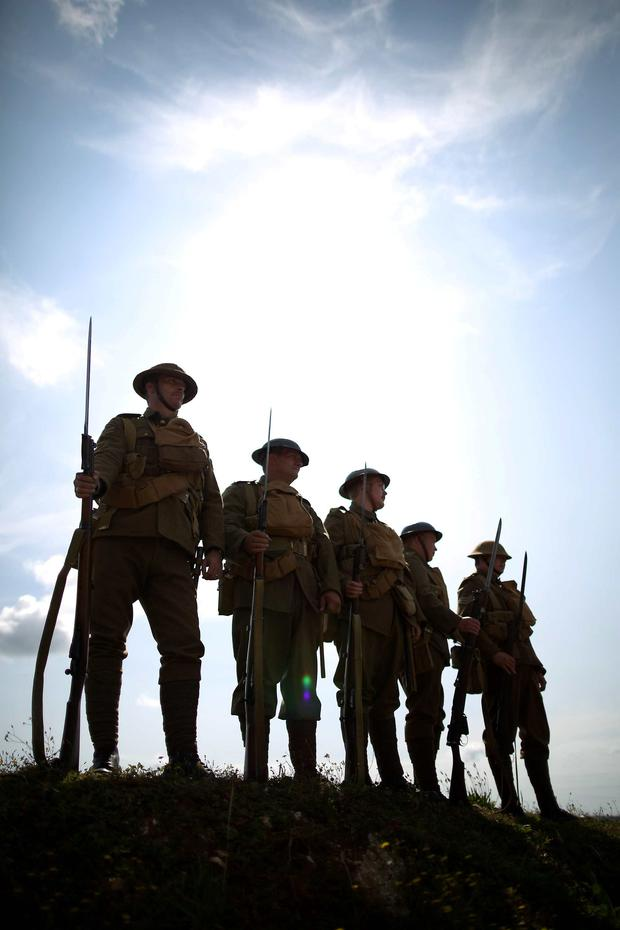 Members of the Great War Society living history group dressed as 4th Battalion the Middlesex Regiment wait to take part in a World War One centenary ceremony at the Tank Museum, Bovington. Photo: Getty Images