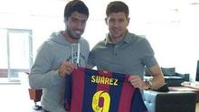 Steven Gerrard pictured with Luis Suarez at Liverpool's Melwood training complex