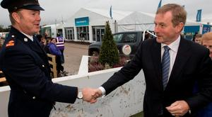 Taoiseach Enda Kenny with Superintendent Joseph Prendergast arriving to the 2015 National Ploughing Championships in Ratheniska, County Laois on Wednesday. Pic:Mark Condren