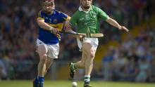 Paddy Stapleton, Tipperary, in action against Sean Tobin, Limerick