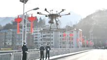 Getting the message out: Police operate a drone to spread information via loudspeakers about the control of the new coronavirus in Xiangyang in Hubei province near Wuhan, the epicentre of the outbreak. Photo: REUTERS