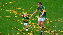 Declan O'Sullivan walks around Croke Park with son Ollie (2) after this year's All-Ireland final victory with Kerry. Photo: Dire Brennan / SPORTSFILE