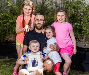 Andrew Houlihan, whose father Jim died from Covid-19, with his children Soraya (8), Sophia (7), Caleb (3) and Sienna (2). Photo: Mark Condren