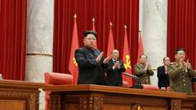 North Korean leader Kim Jong Un (L) supervises an expanded meeting of the Political Bureau of the Central Committee of the Workers' Party of Korea