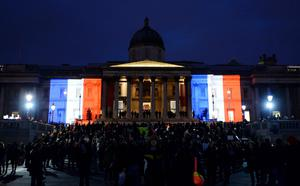 The National Gallery in London's Trafalgar Square is illuminated with the colours of the French Tricolore flag, in support of the victims of recent terrorist attacks in France, including on the satirical magazine Charlie Hebdo (Stefan Rousseau/PA Wire)