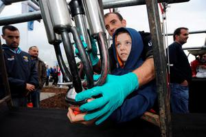 23 Sept 2014;  Dean Earle, 13, from Gorey, Wexford, tries his hand at a milking machine. National Ploughing Championships 2014. Ratheniska, Stradbally, Co. Laois. Picture: Caroline Quinn
