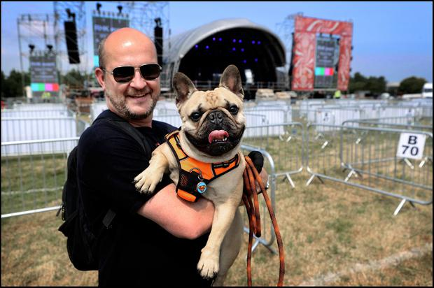 Edwin Cummins and his dog 'Whitney Houston' pictured at Kilmainham as the set up continues of Irelands first big music festival featuring Gavin James and Lyra to name a few band performing this weekend. Photo by Steve Humphreys 2nd July 2021.