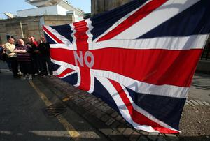 """Spectators watch an Orangemen march through the streets of Edinburgh during a """"Proud to be British"""" rally in Edinburgh in support of the Union. Andrew Milligan/PA Wire"""