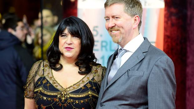 British writer E L James (L) and her Irish-born husband Niall Leonard walk on the red carpet as they arrive for the screening of Fifty 'Shades of Grey' as part of Berlinale Special Gala at the 65th Berlin International Film Festival Berlinale in Berlin, on February 11, 2015.