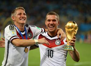 Germany's Bastian Schweinsteiger (left) and Lukas Podolski celebrate winning the World Cup