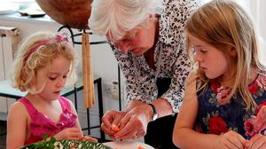 Myrtle Allen helping her great grandchildren Scarlett and Amelia to peel shrimps. Photo: Tim Allen