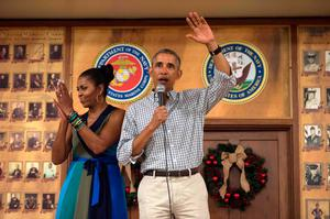 US President Barack Obama addresses troops with First Lady Michelle Obama at Marine Corps Base Hawaii in Kailua