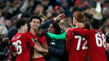 Liverpool's Curtis Jones, second left, celebrates with teammates after win over Arsenal