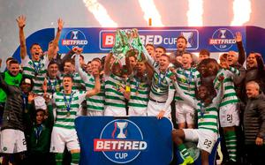 CHAMPIONS: Celtic players and staff celebrate with the Betfred Cup trophy after their win over Aberdeen. Pic: PA Wire