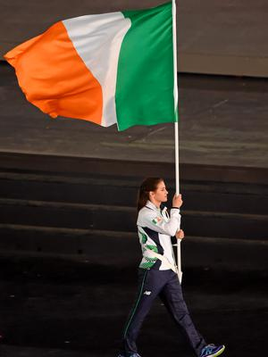 12 June 2015; Ireland flag bearer Katie Taylor during the 2015 European Games Opening Ceremony at the Olympic Stadium in Baku, Azerbaijan. Picture credit: Stephen McCarthy / SPORTSFILE