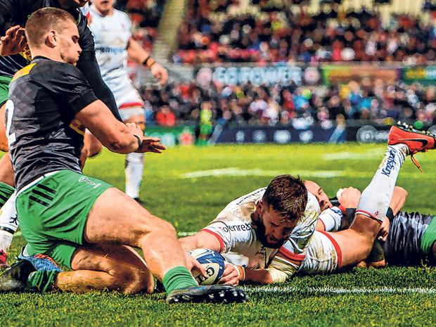 Stuart McCloskey evades the clutches of two Harlequins tacklers as he goes over for Ulster's second try on Saturday. Photo: Oliver McVeigh/Sportsfile