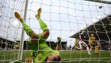 Burnley's Jay Rodriguez reacts after his shot bounces from the crossbar