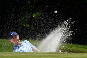 Rory McIlroy hits out of a bunker at the 11th green during the third round of the Charles Schwab Challenge golf tournament at the Colonial Country Club in Fort Worth, Texas.. (AP Photo/David J. Phillip)