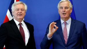 Britain's former Secretary of State for Exiting the European Union David Davis and European Union's chief Brexit negotiator Michel Barnier pose ahead of a meeting in Brussels, Belgium, March 19, 2018.  REUTERS/Francois Lenoir