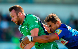 Shane O'Leary, Connacht, is tackled by Nigel Hunt, Grenoble
