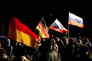 "Participants carry German and Russian flags as they take part in a demonstration called by anti-immigration group PEGIDA, a German abbreviation for ""Patriotic Europeans against the Islamization of the West"", in Dresden January 5, 2015. REUTERS/Fabrizio Bensch"