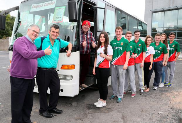 Castlebar Publican Mick Byre (2nd from left) is getting Quigley's Coaches to get some Mayo supporters to Croke Park, on Sunday next, pictured with driver Sean Gallagher and Martin Quigley. Photo: Michael Donnelly