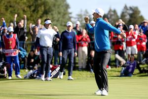 Justin Rose of Europe celebrates winning the first point for Europe on the 14th green during the Morning Fourballs of the 2014 Ryder Cup