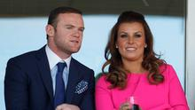 Manchester United football player Wayne Rooney and his wife Coleen