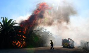 Fire erupts close to one of many ranches near the Ronald Reagan Presidential Library in Simi Valley, California, during the Easy Fire on October 30, 2019.  Photo by FREDERIC J. BROWN/AFP via Getty Images
