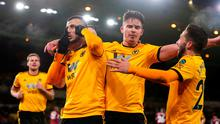 Wolverhampton Wanderers' Romain Saiss (second left) celebrates scoring his side's first goal of the game with team-mates during the Premier League match at Molineux, Wolverhampton. David Davies/PA Wire.