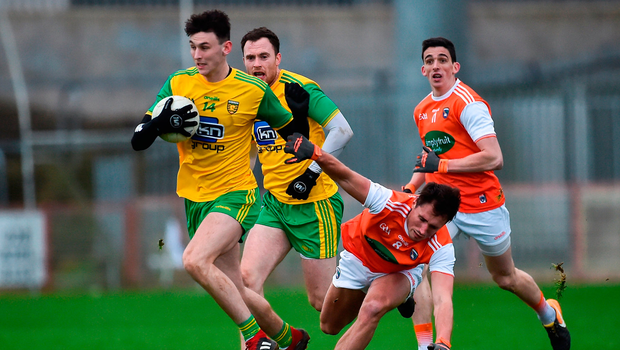 Michael Langan of Donegal in action against Stephen Sheridan of Armagh. Photo by Oliver McVeigh/Sportsfile