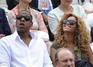 US singer Beyonce (R) and her husband US rap singer Jay-Z (L) watch the men's final match between Spain's Rafael Nadal and Sweden's Robin Soderling in the French Open tennis championship at the Roland Garros stadium in 201