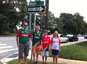 """""""Where the streets are called Mayo"""" - The Farrell family (Gerry, Lorcan, Darragh, & Aoife) on Mayo St. in Raleigh, North Carolina after watching the semifinal. The boys are lucky enough to be heading to Croke Park for the final."""