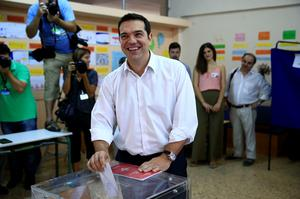 Leader of left-wing Syriza party and former Prime Minister Alexis Tsipras casts his vote at a polling station in Athens. (AP Photo/Lefteris Pitarakis)