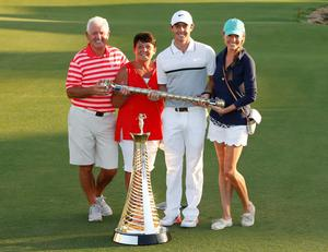 Rory McIlroy celebrates with his Father Gerry, mother Rosie and girlfriend Erica Stoll after winning The Race to Dubai and DP World Tour Championship. Photo: Reuters / Paul Childs