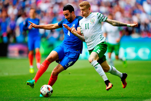 Adil Rami and James McClean go shoulder-to-shoulder.  (Photo by Laurence Griffiths/Getty Images)