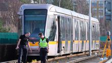 Investigation: Gardaí at the scene in Tallaght where a woman died after being hit by a Luas tram yesterday. Photo: Niall Carson/PA Wire