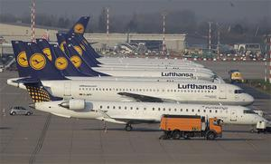 Lufthansa airplanes are parked during a warning strike by employees of the German airline in Duesseldorf, Germany, yesterday