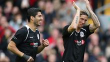 Luis Suarez and Fernando Torres making their way onto the pitch at Anfield yesterday