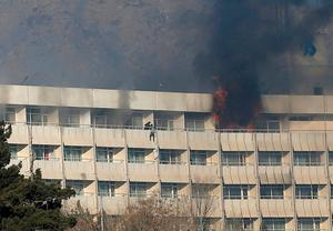 A man tries to escape from a balcony at Kabul's Intercontinental Hotel during an attack by gunmen in Kabul, Afghanistan January 21, 2018. REUTERS/Omar Sobhani