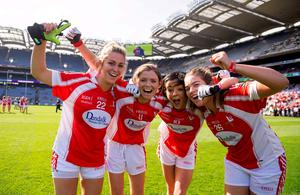 Louth players (l-r) Lisa Finglas, Susan Byrne, Paula Murray, and Katie Anne Holdcroft celebrate after beating Scotland