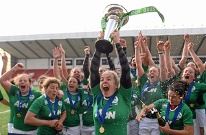 Ireland captain Niamh Briggs lifts the Women's Six Nations Rugby Championship trophy.