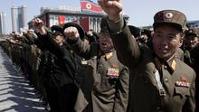 North Korean army officers punch the air as they chant slogans during a rally at Kim Il Sung Square in downtown Pyongyang, North Korea