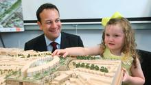 Health Minister Leo Varadkar and Olivia Evans (3) from South Circular Road, Dublin, with a model of the new National Children's Hospital