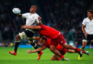 Leone Nakarawa of Fiji is tackled by Mako Vunipola and Sam Burgess of England during their Rugby World Cup match at Twickenham.  Photo by Paul Gilham/Getty Images.